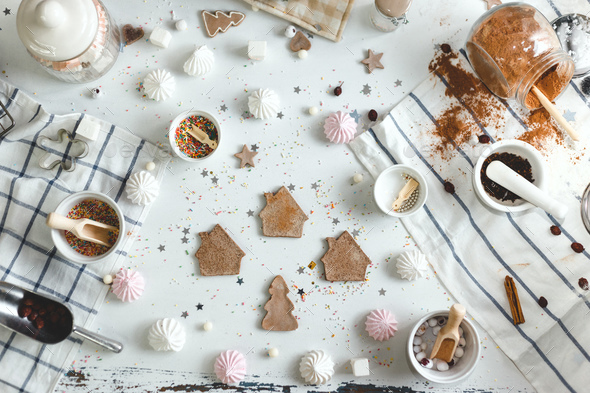 Ginger biscuits cooked at home on a white wood table with different sweets. top view - Stock Photo - Images
