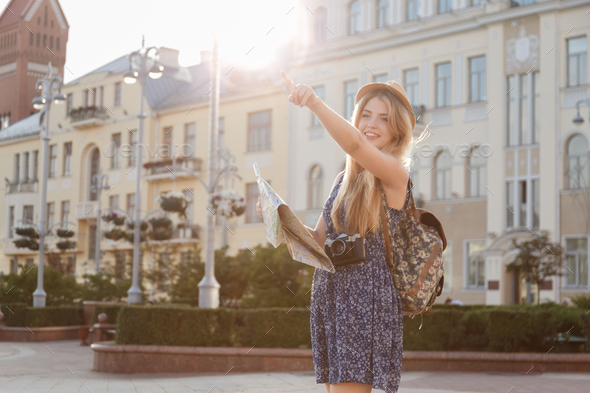 Woman holding city map and finger pointing up - Stock Photo - Images