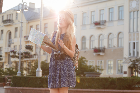 Young woman with city map as tourist - Stock Photo - Images