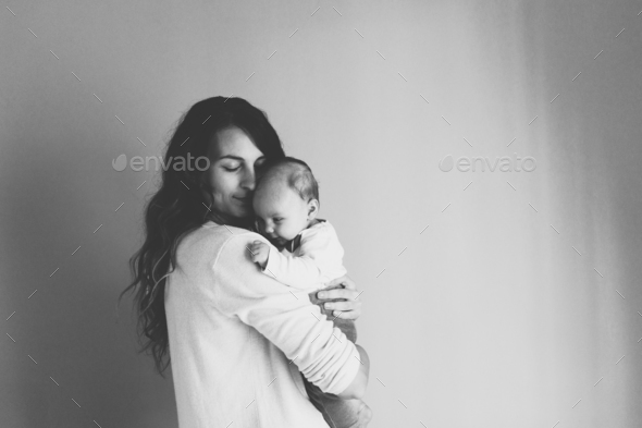 Happy mother holding adorable  baby girl - Stock Photo - Images