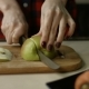 Female Hands Slicing Apple on Cutting Board - VideoHive Item for Sale