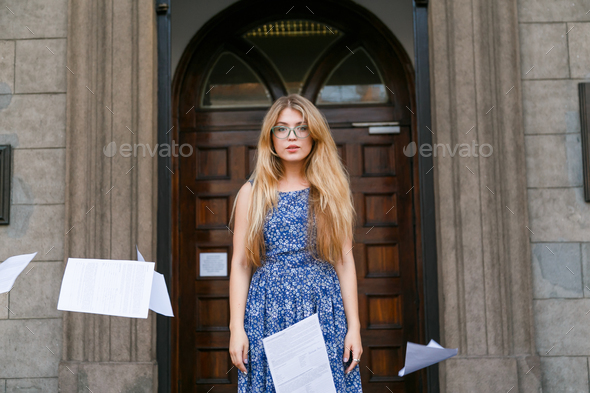 Young woman threw the papers in casual and paper flying in air. Freedom concept - Stock Photo - Images