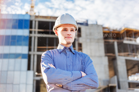 Portrait of a foreman on construction background - Stock Photo - Images
