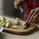 Female Hands Chopping Apple on Cutting Board - VideoHive Item for Sale