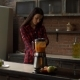 Woman Blending Homemade Smoothie in Kitchen - VideoHive Item for Sale