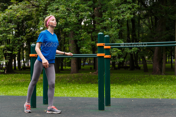 Young girl doing gymnastics in the park - Stock Photo - Images