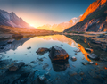 Mountains with illuminated peaks, stones in mountain lake at sunset - PhotoDune Item for Sale