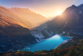 Mountains and lake with blue water at sunset - PhotoDune Item for Sale