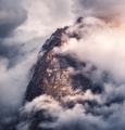 Majestical mountains in clouds in overcast evening - PhotoDune Item for Sale
