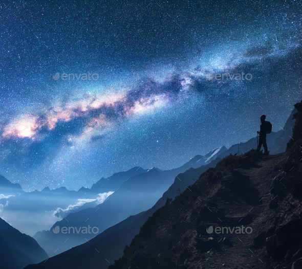 Space with Milky Way, girl and mountains at night - Stock Photo - Images