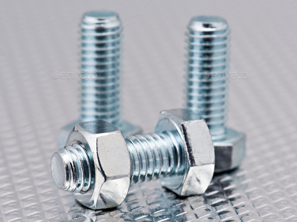 nuts and bolts bright group, randomly arranged bright metal background - Stock Photo - Images