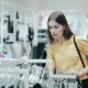 Woman Looking at Clothes on Rail in Clothing Store - VideoHive Item for Sale