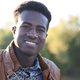 Handsome smiling young black man on defocused background - PhotoDune Item for Sale