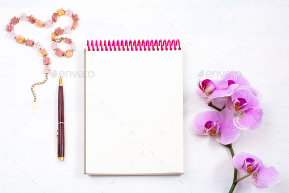 Mockup with notepad, pen and pink orchid, top view - Stock Photo - Images