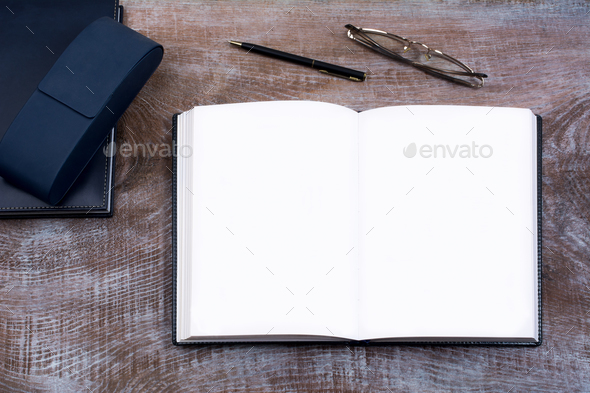 Mockup of open notebook with blank pages. - Stock Photo - Images