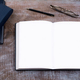 Mockup of open notebook with blank pages. - PhotoDune Item for Sale