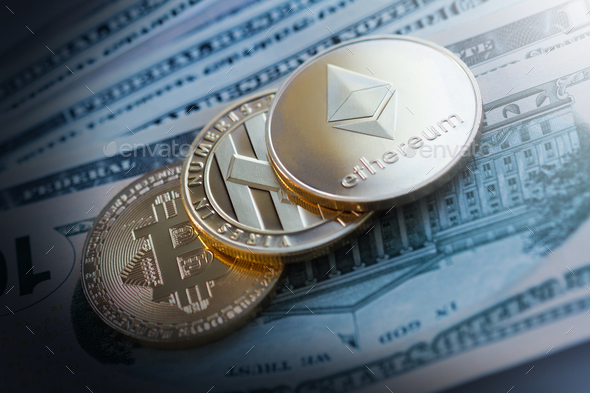 golden cryptocurrency coins on dollar bills - Stock Photo - Images