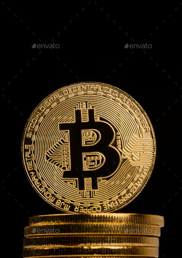 closeup of golden bitcoin on pile of metallic coins - Stock Photo - Images