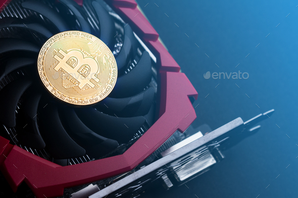 cryptocurrency mining concept with golden bitcoin - Stock Photo - Images