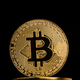 closeup of golden bitcoin on pile of metallic coins - PhotoDune Item for Sale