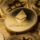 close up of ethereum on a stack of bitcoin golden coins - PhotoDune Item for Sale