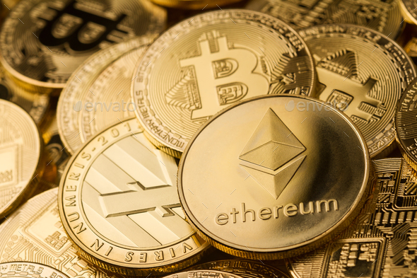 close up of ethereum litecoin and bitcoin stack of golden coins - Stock Photo - Images