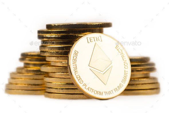 golden ethereum in front of a pile of golden metallic coins on w - Stock Photo - Images