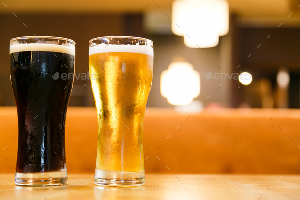 Two glasses of fresh cold beer. A glass dark and light. - Stock Photo - Images
