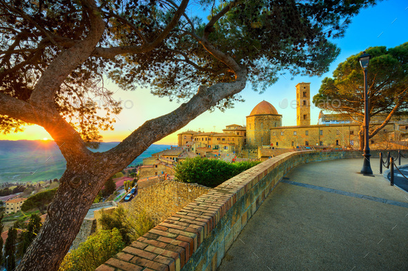Tuscany, Volterra town skyline, church and trees on sunset. Ital - Stock Photo - Images