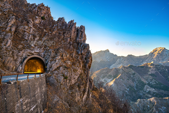 Alpi Apuane mountain road pass and tunnel view at sunset. Carrar - Stock Photo - Images
