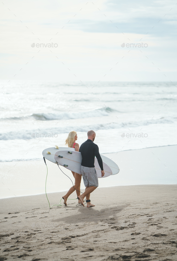 Young surfers on the beach - Stock Photo - Images