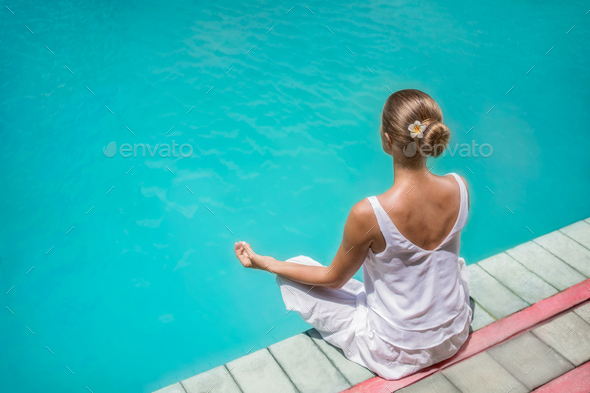 Yoga by the pool - Stock Photo - Images