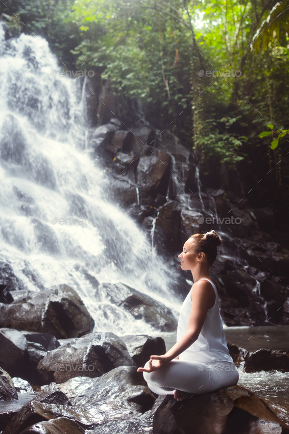 Yoga on the waterfall - Stock Photo - Images