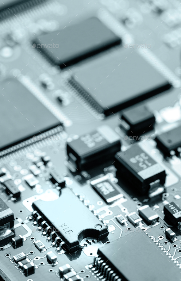 Electronic chips mounted on motherboard - Stock Photo - Images