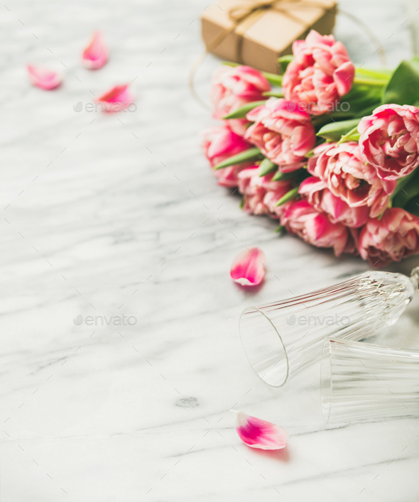 Pink tulips, champaign glasses and gift box with copy space - Stock Photo - Images