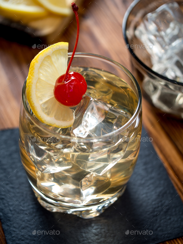 Glass of whiskey sour cocktail - Stock Photo - Images