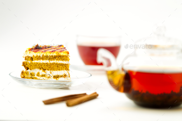 Teapot, tea cup and cake on white background - Stock Photo - Images
