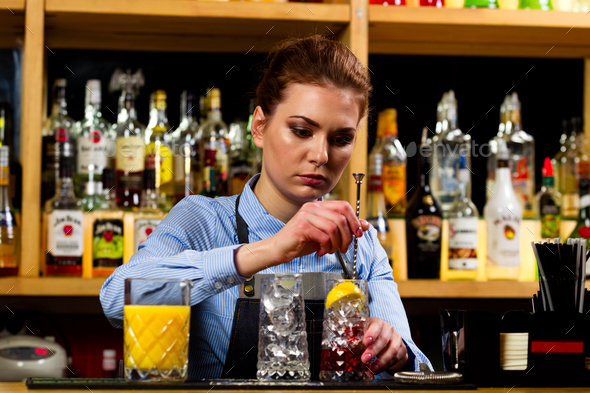 The bartender prepares cocktails at the bar - Stock Photo - Images