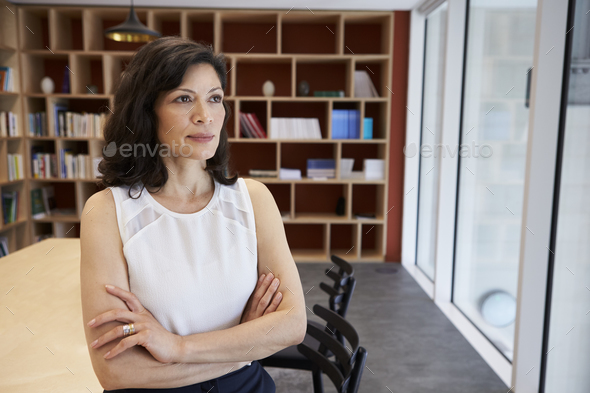 Middle aged female media creative in her office - Stock Photo - Images