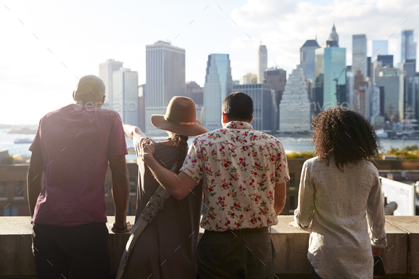 Rear View Of Tourists Looking At Manhattan Skyline - Stock Photo - Images