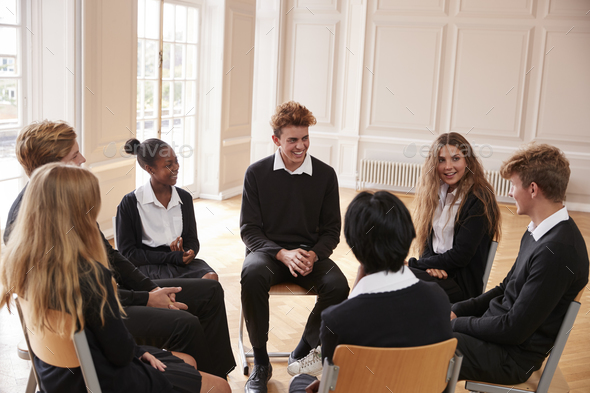 Group Of Teenage Students Having Discussion In Class Together - Stock Photo - Images