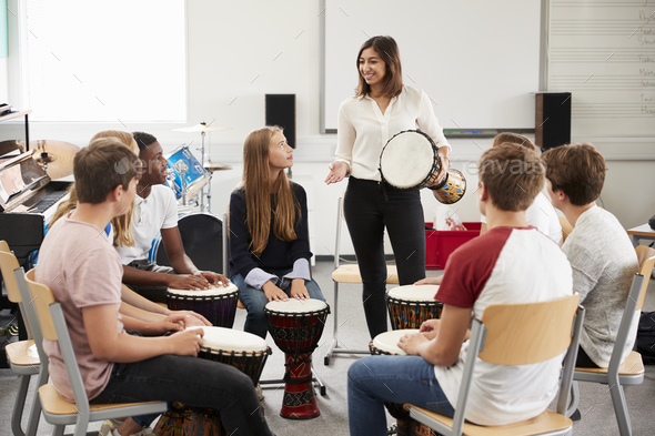 Teenage Students Studying Percussion In Music Class - Stock Photo - Images