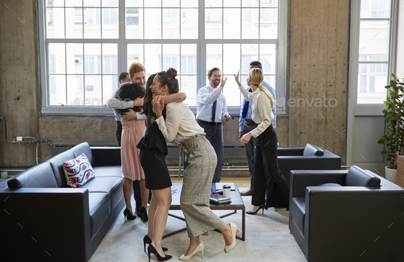 Happy business team celebrate hitting target at meeting - Stock Photo - Images