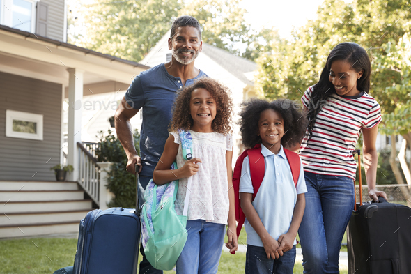 Portrait Of Family With Luggage Leaving House For Vacation - Stock Photo - Images