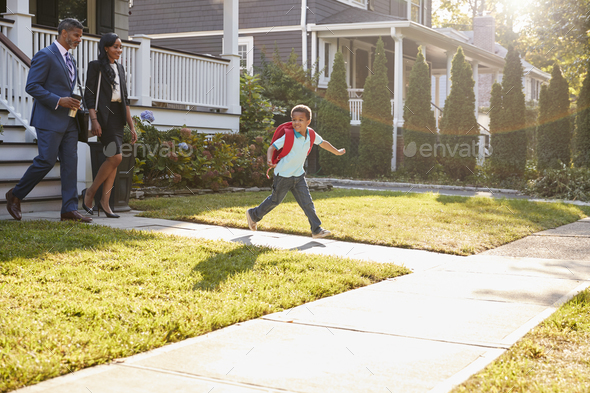 Businesswoman Parents Walking Son To School On Way To Work - Stock Photo - Images