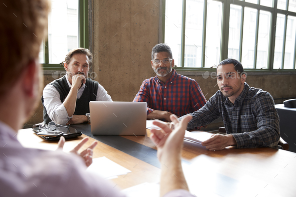 Casually dressed male colleagues at a meeting, close up - Stock Photo - Images