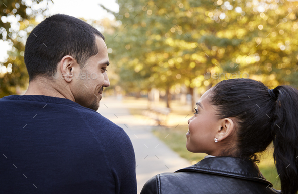 Young Hispanic couple walking in Brooklyn park, back view - Stock Photo - Images