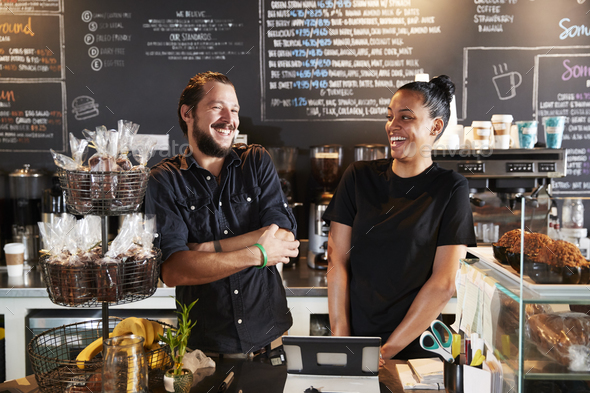 Male And Female Baristas Behind Counter In Coffee Shop - Stock Photo - Images