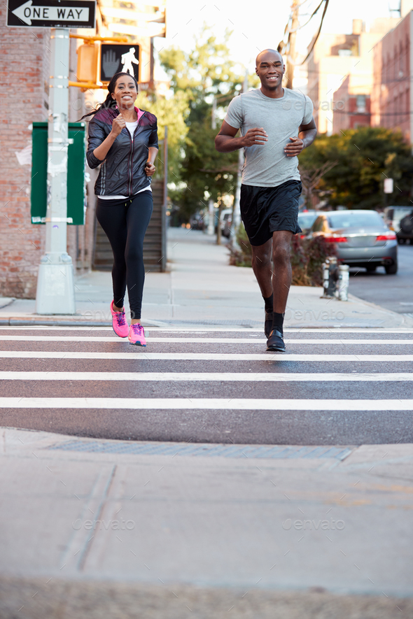 Young black couple jogging in Brooklyn, vertical - Stock Photo - Images