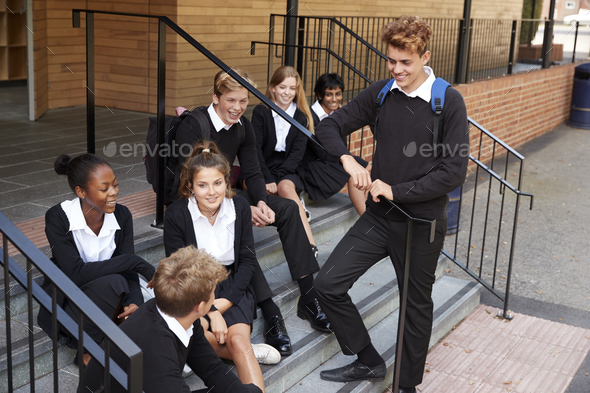 Group Of Teenage Students In Uniform Outside School Building - Stock Photo - Images